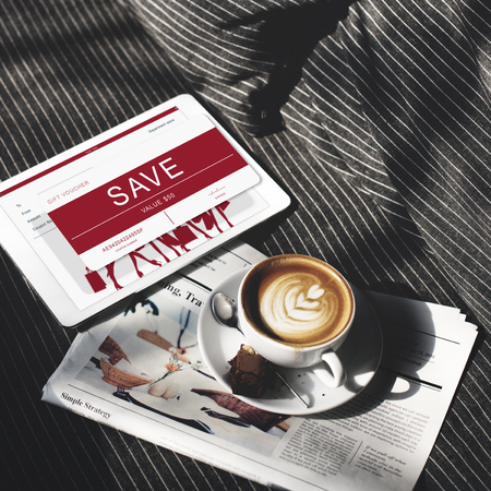 Save concept in digital tablet with coffee and newspaper