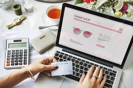 owed: E-shopping Online Shopaholic Paying Credit Card Concept