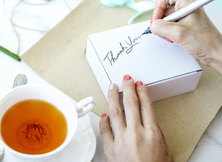 unwrapped: Unwrapped Present Writing Thankyou Message Concept