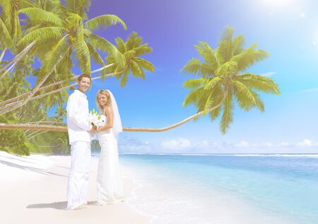 Couple getting marriage on the beach.