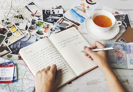 Hands Writing Travel Journal Tea Concept Stock Photo