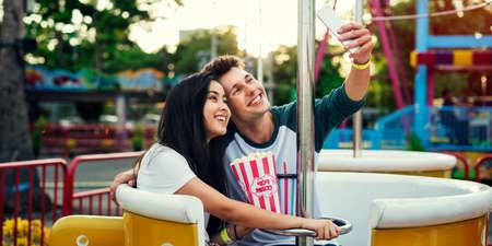 enjoyment: Couple Dating Amusement Park Enjoyment Hugging Concept Stock Photo