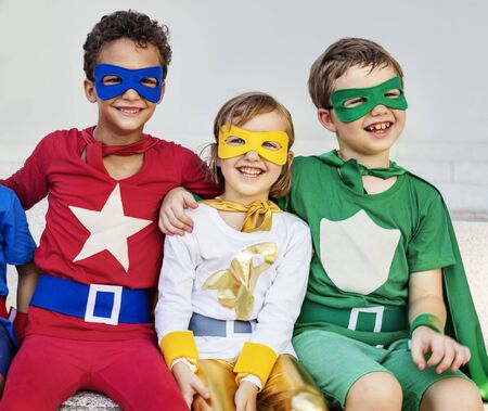 superheroes: Superheroes Kids Friends Playing Togetherness Concept Stock Photo