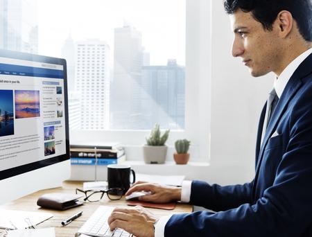 man working computer: Businessman Working Using Computer Information Concept