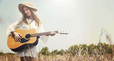 girl playing guitar: Girl Playing Guitar Writing Song Concept