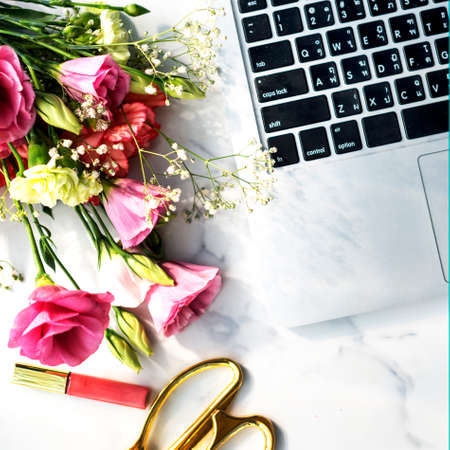lipgloss: Flowers Lipgloss Laptop Desk Concept Stock Photo