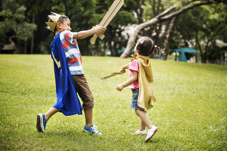Siblings Playful Dressup Park Concept Stock Photo