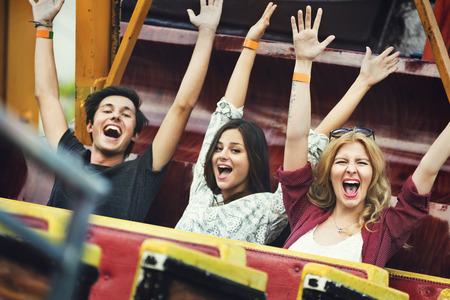 carnival ride: Friends Carnival Ride Fun Hands Raised Concept