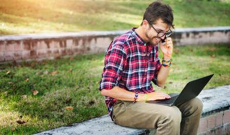 phonecall: Man Sitting Park Phonecall Concept