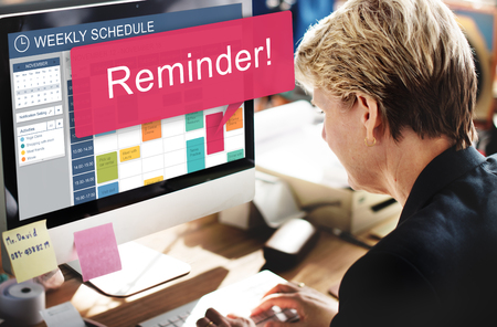 Woman at work with weekly schedule on screen Stockfoto - 110850469