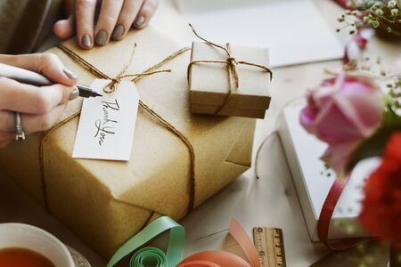 pack string: Woman Writing Card Gift Present Concept