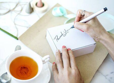 thankyou: Unwrapped Present Writing Thankyou Message Concept