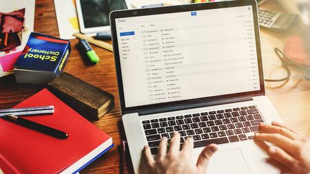 replying: Laptop Workspace Library Dictionary Concept Stock Photo