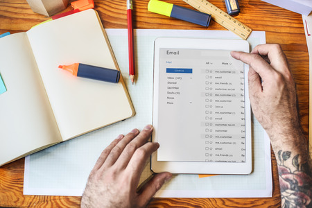 replying: Tablet Emails Book Workspace Concept Stock Photo