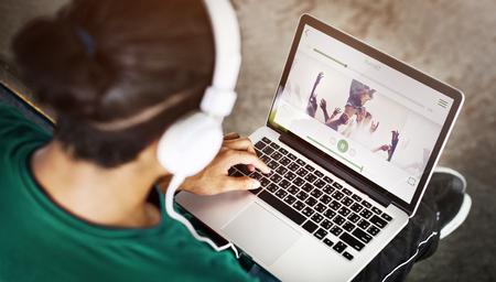 playlist: Boy Headphones Laptop Playlist Concept