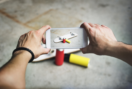 arts culture and entertainment: Skateboard Spray Can Graffiti Mobile Phone Photography Concept
