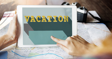 Person using a digital tablet with vacation concept