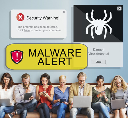 Group of people using digital devices with malware alert Stock Photo