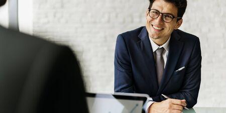 communicating: Businessman Communicating Meeting Success Concept Stock Photo