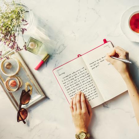 feminine: Woman Writing Diary Feminine Glamour Concept