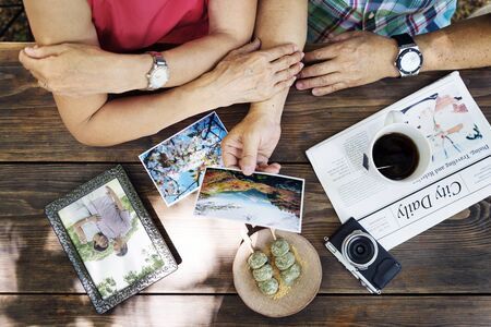 reminding: Senior Adult Reminding Memory Photos Couple Concept