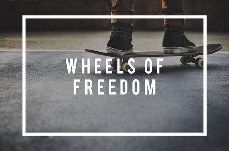 skater boy: Wheel of Freedom Skater Boy Skating Skateboarding Concept Stock Photo