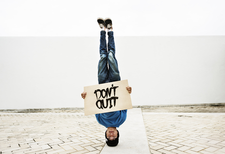 Man Holding Speech Sign Dont Quit Cocncept Stock Photo
