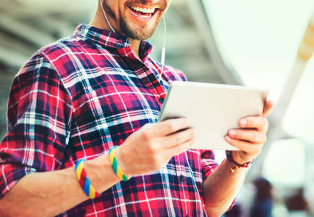 Guy Smiling Watching Tablet Outdoors Concept Stock Photo