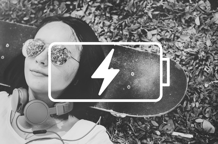 woman lying down: Battery Charge Charger Energy Power Concept