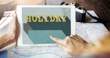 Person holding a digital tablet with holiday concept Imagens