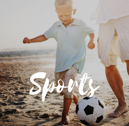 Boy and father at beach with sports concept