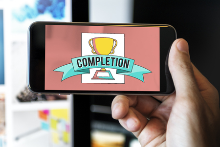 Person holding a smartphone with completion concept