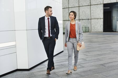 hurrying: Business People Partner Walking Talking Concept