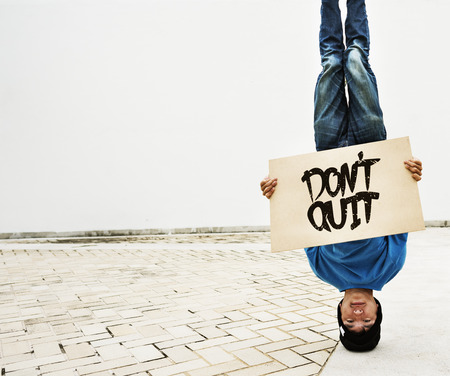 Man Holding Speech Sign Don't Quit Cocncept