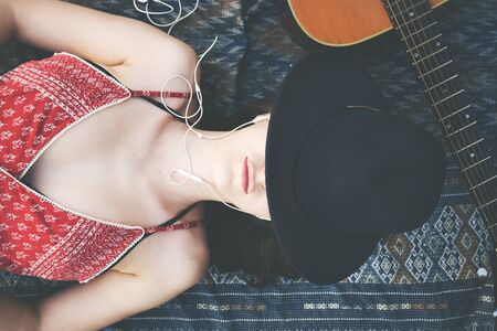 down beat: Female Outdoors Relax Guitar Music Concept