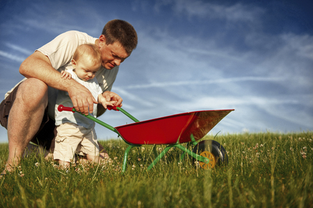 english ethnicity: Father and Son Playing Together Concept