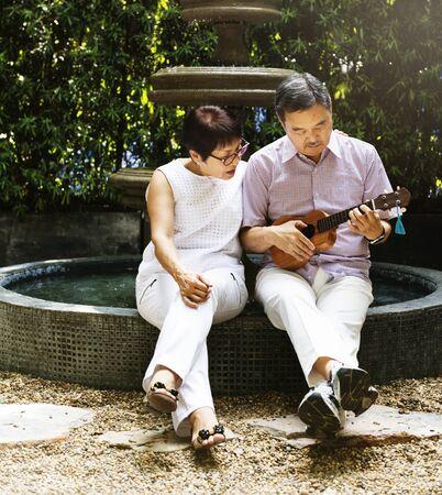ukelele: Senior Couple Fountain Ukelele Instrument Concept