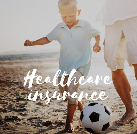 Boy and man outdoors with healthcare insurance
