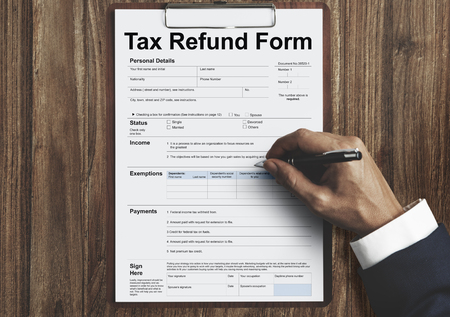 Man filling tax refund form