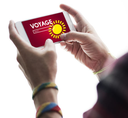 Person holding a smartphone with voyage concept Stock Photo