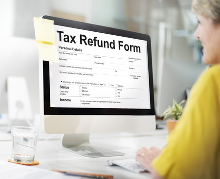Woman at work with tax refund form