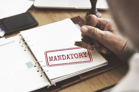 mandatory: Mandatory Necessary Imperative Requisite Concept Stock Photo