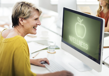 Woman at work with wellness concept