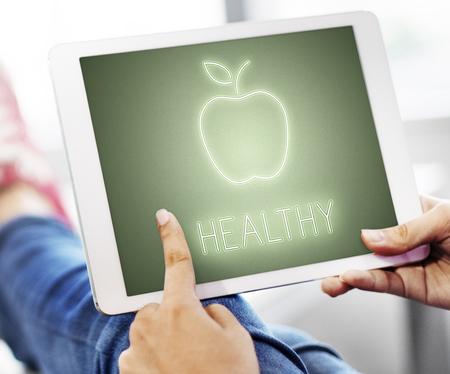 Woman using a digital tablet with healthy concept