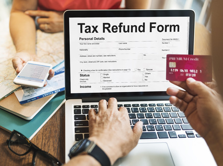 Person filling up a tax refund form