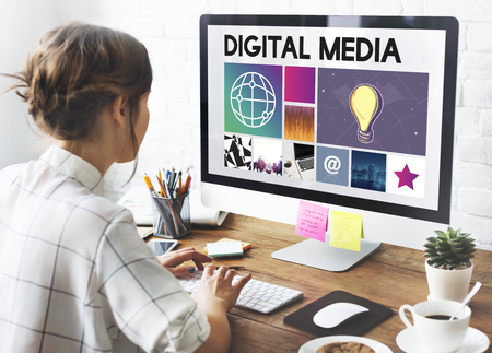 Woman looking at digital media concepts on a monitor