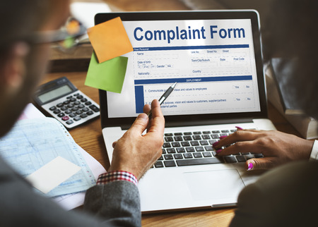 People filling up a complaint form online