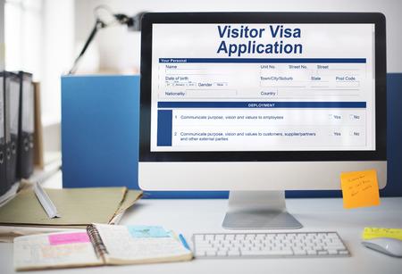 Visitor visa application in a monitor Фото со стока
