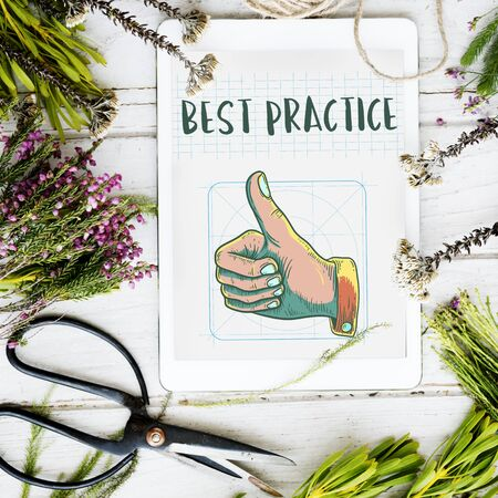 accomplishments: Best Practice Thumbs Up Approval Concept Stock Photo