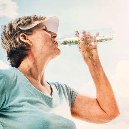 refreshment: Water Thirsty Refreshment Beverage Drink Senior Concept Stock Photo